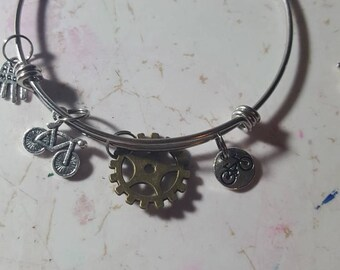 Stainless steel bangle bracelets.  Bikes. Cogs. Bike riders. 2/8.00