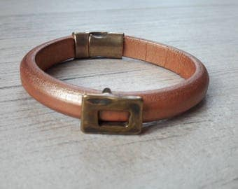 Golden brown thick leather strap. from bronze. mixed bracelet