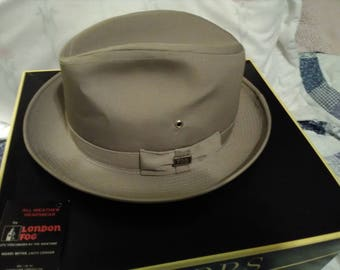 London Fog Men's hat size 7. All weather headgear.  Never  worn.