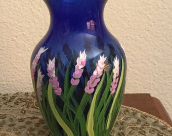 Blue glass vase with hand painted flowers