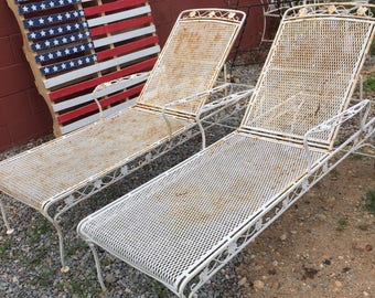 Vintage pair of iron chaise lounge chairs with wheels