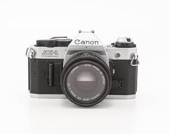 Canon AE1 Program with Canon FD 50mm 12.8 Lens - Manual 35mm Film Camera - guaranteed working great student camera