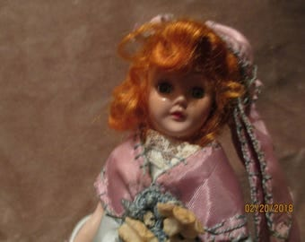 Eye catching miniature doll from the mid-century