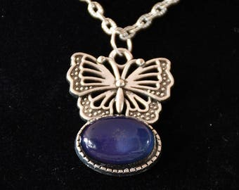 necklace with butterfly pendant and fitted cabochon with misty stone.