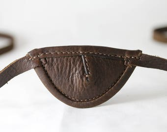 Slim, brown, concave - leather eye patch