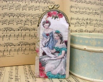 Vintage eyeglass case with Victorian ladies, kiss lock purse