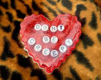 Dont be creepy large glittery heart brooch