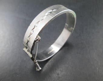 Vintage Cut Silver Tone Hinged Bangle Bracelet with Safety Chain by Roget made in West Germany Signed