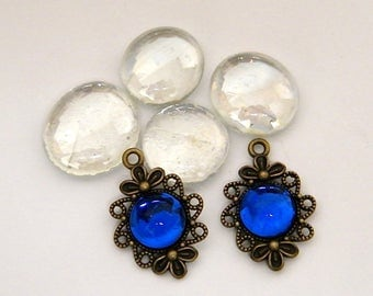 2 charms, pendants bronze, ultramarine blue glass cabochons