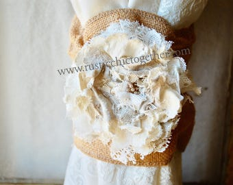 Curtain tie back with white rosette on natural burlap