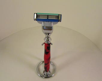 Handcrafted  : Mach 3 (TM)  (Chrome  finished Razor  in a (Raspberry Swirl (TM)Acrylic Blank--with  Chrome Finish Stand)