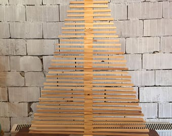 Ecological Christmas tree in raw wood