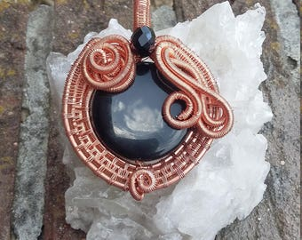 Black agate in copper pendant