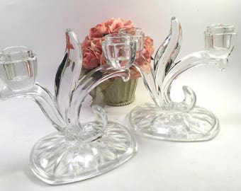 Pair clear glass double taper candle holders with large oblong cut base, leaves & flower buds