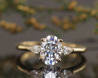Oval Three Stone Engagement Ring with Pear Diamond Accents, 8x6mm/1.52ct Oval F1 Moissanite, 0.15ctw Diamonds, 1.6mm Band, Lilian B