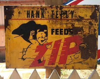 Vintage Zip Feeds Advertising Painted Metal Sign