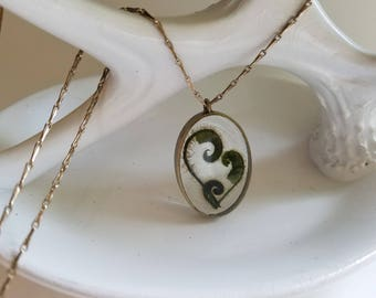 "Fiddlehead ferns in antique gold frame on 30"" fine linked chain w 3"" extender. 15 dollars from this sale will benefit music students"