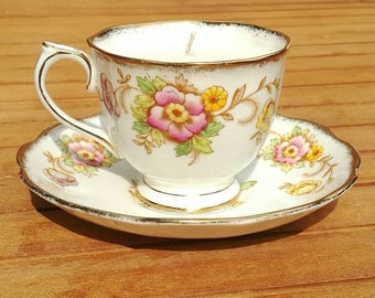 Soy wax candle in vintage teacup with saucer