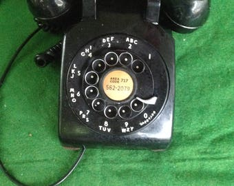 Vintage black rotary telephone with metal dial