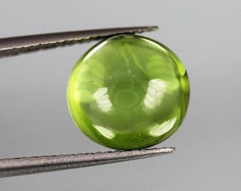 5.50ct top green color,Round cut peridot Cabochon From Pakistan.