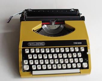 Typewriter - Wilding TW200 mustard, fully working. Brand new ribbon.