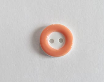 Pretty pale orange and white button with circle front