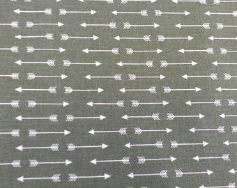 100 percent cotton green fabric with arrows/crafts/apparel/quilting