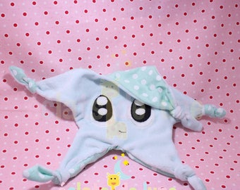 Flat plush star with big blue eyes