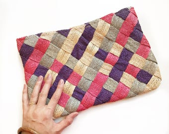 Summery oversized woven pink and purple rafia clutch.