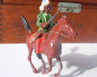 Antique Toy Figures from a Toy Soldier Company / Britains' Ltd London / Indian on Horseback with rifle