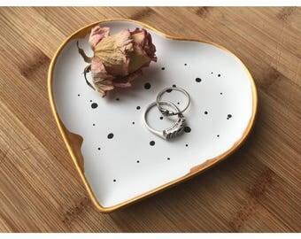 Unglazed, raw, illustrated ceramic heart shaped jewellery dish
