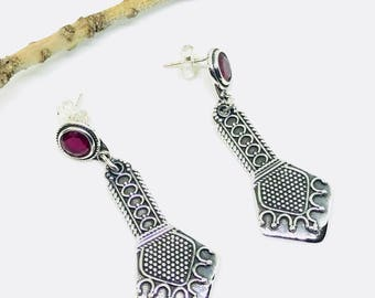 Ruby Earrings set in sterling silver(92.5). Genuine Ruby stones. July Birthstone. Perfectly matched . Length-1.75 inch long.