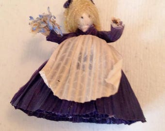 Tiny Vintage Handmade Cornhusk Doll in Blue Pioneer Dress and Apron holding Flowers. Miniature Handmade Iowa Cornhusk Doll.