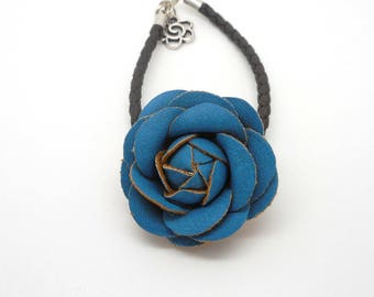 imitation black leather and blue flower bracelet