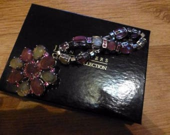 Joan Rivers bracelet and broach set. Signed. Designer