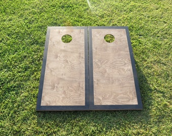 cornhole boards with a light stain and border wbags includedfathers day - Cornhole Design Ideas