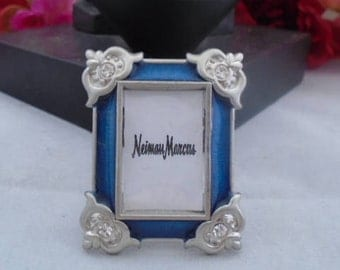 Vintage Jay Strongwater Blue Mini Photo Frame with Silvertone Hardware and Silvertone Flowers as Trim on the Frame. Have had it at home.
