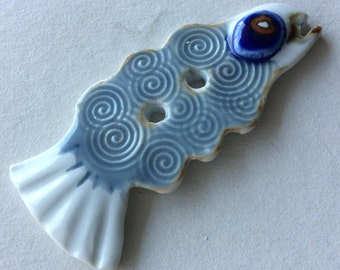 Showpiece, collector's 3-inch, blue swirl, fish button, one-of-a-kind, signed, handmade porcelain ceramic button