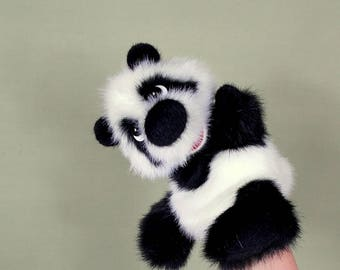 Baby panda. Toy glove. For small hand. Toy on hand. Bibabo. Puppet theatre. Marionette.