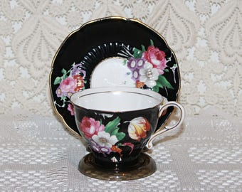 """Paragon """"BLACK"""" Teacup and Saucer Pink,Whites,Purples,Oranges Large Floral Arrangement on Footed Cup"""
