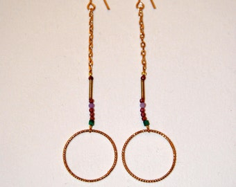 Long gold-plated twisted circle earrings