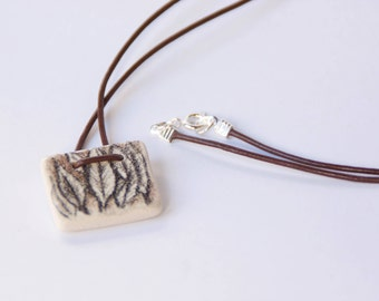Pendant with handmade drawings