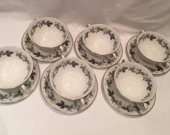"""Set of 6 Royal Doulton """"Burgundy"""" 2 handled Soup bowls and Saucers TC1001 pattern - 1959 to 1981 decorated with Maple leaves"""