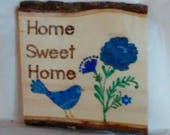 Home Sweet Home sign wood burned flowers and bird painted in blues embellished with colored crystals