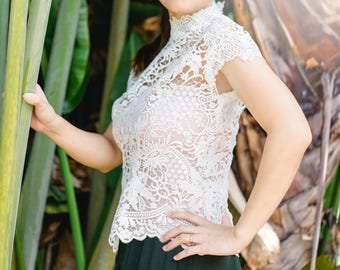 """Vine Forest Lace Top. Mock Neck With Short-Batwing Sleeve. Back Zipper with Clear Button on Top. Bust 35"""" Length 21"""" Ships Worldwide."""