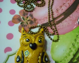 Metal bronze necklace with a yellow owl made with polymer clay