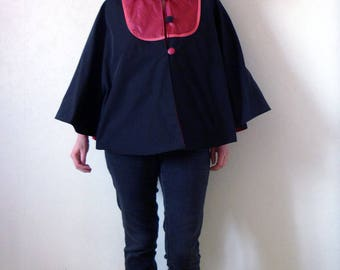 Waterproof Cape with a large black and Red hood