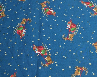 Santa's Sleigh on Blue Cotton Fabric