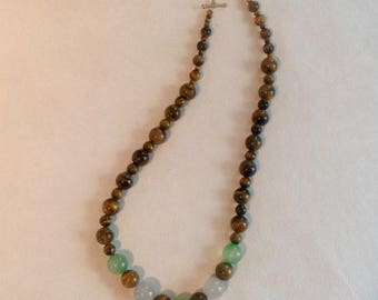 Necklace of green and white agate round beads and Tiger's eye.