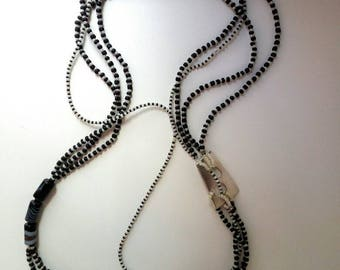 Modern necklace with steel element design
